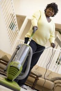 Woman Using In Two-Story House After Our Vacuum Service